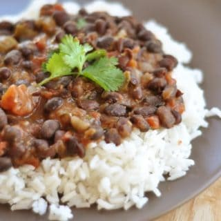 white rice with black bean mixture and parsley on top