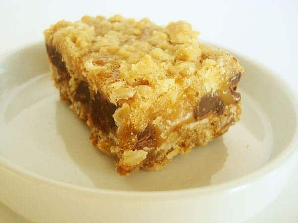 oatmeal chocolate chip caramel bar on a white plate