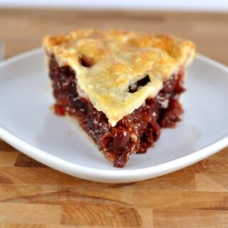 slice of cherry pie on a white plate