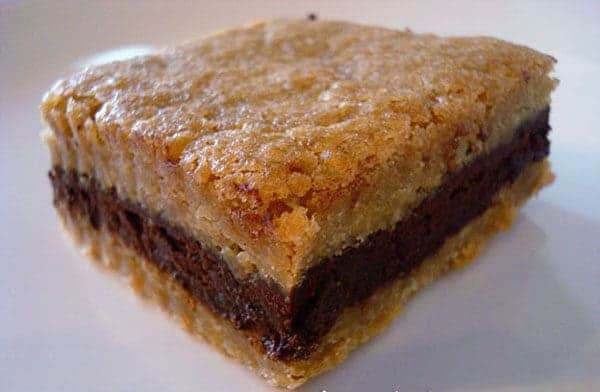 brown sugar bar with a dark chocolate layer on a white plate