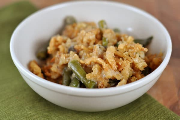 white bowl with green bean casserole topped with fried onions