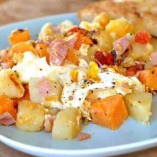 sweet potato, potato, egg, and ham hash scooped messily on a plate