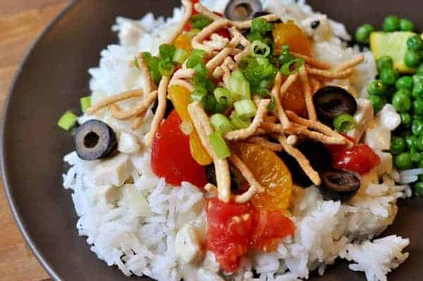 white rice with hawaiian haystack toppings on a black plate