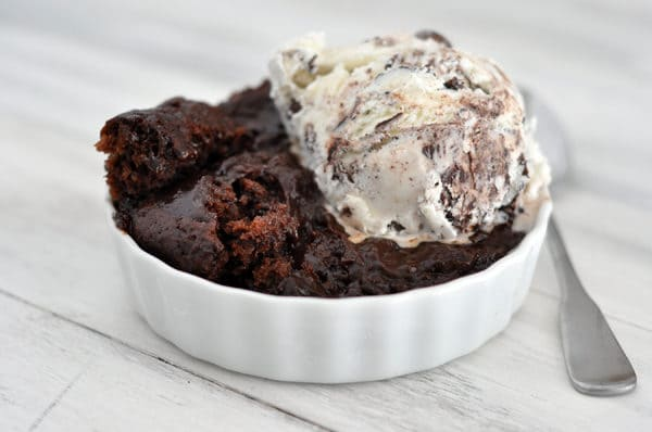 white ramekin with chocolate pudding cake a scoop of ice cream