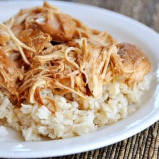 shredded chicken on a bed of white rice