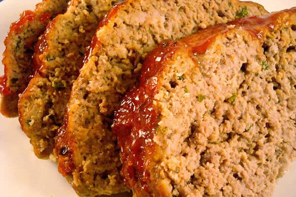 thick meatloaf slices on a white plate