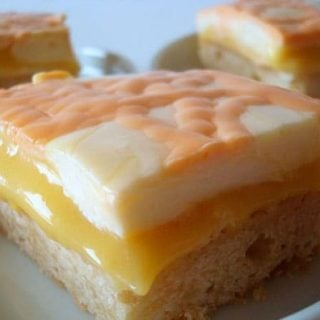 shortbread based bar with orange middle and cream top