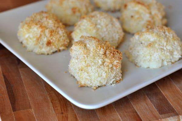 small, golden potato puffs on a white rectangular platter