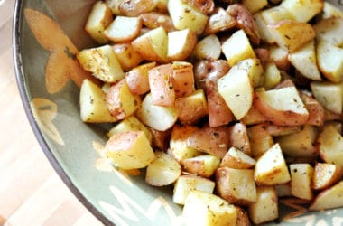 diced, herb- roasted potatoes in a bowl