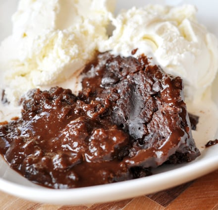 chocolate pudding cake and vanilla ice cream in a white bowl