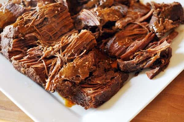 white platter with shredded sweet and spicy pot roast