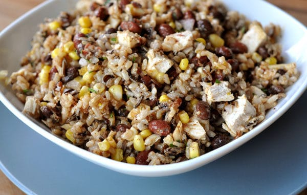 southwest rice, bean, corn, and chicken salad in a white bowl