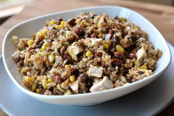 white bowl of rice, corn, chicken and beans