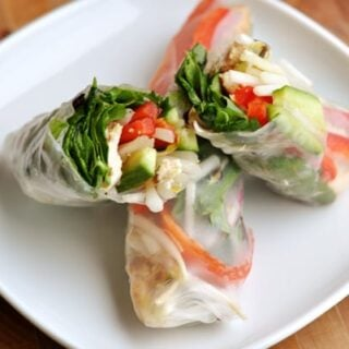 cut open spring roll on a white plate