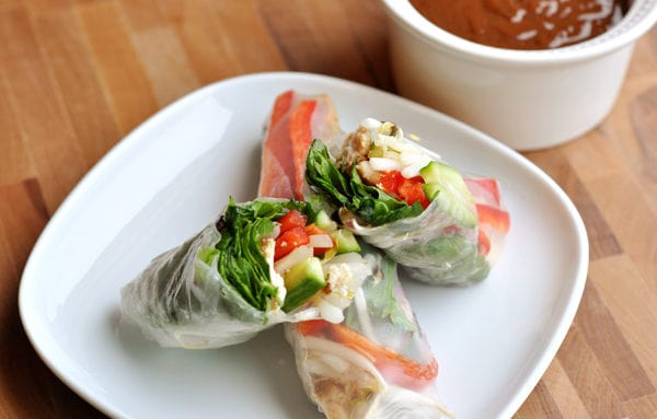 spring roll cut in half on top of a full spring roll