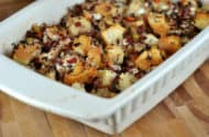 white casserole dish full of goat cheese and wild rice stuffing