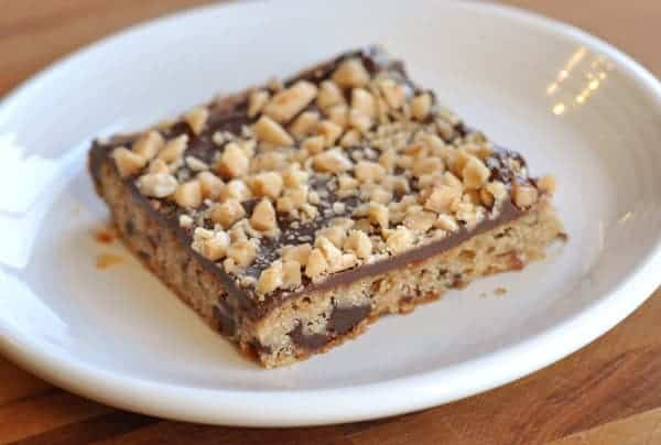 chocolate toffee shortbread bar on a white plate