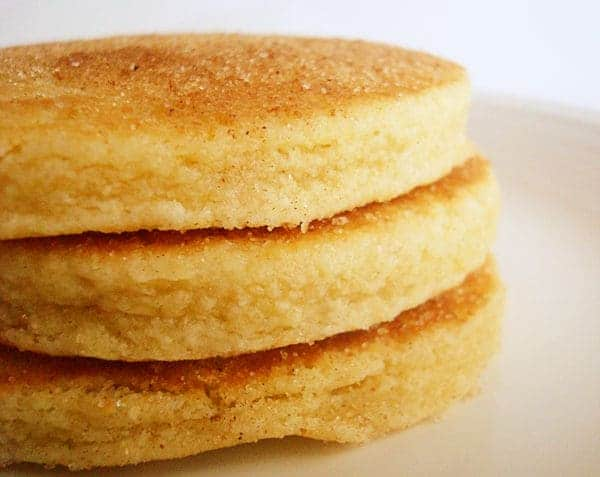 stack of three thick pancakes on a white plate