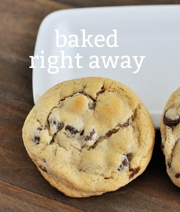 top view of a chocolate chip cookie with the text baked right away over the top of the cookie
