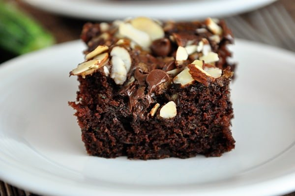 a piece of streusel-topped chocolate zucchini cake on a white plate