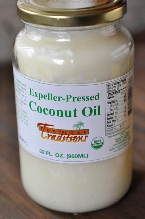 glass jar of expeller-pressed coconut oil