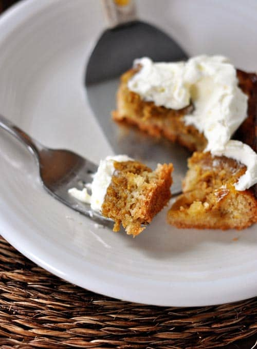 a slice of pumpkin sheet cake with a bite being taken out with a fork