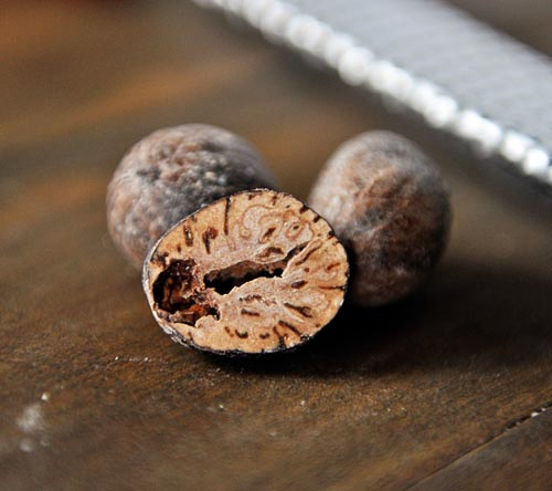 three balls of nutmeg with the front one split in half