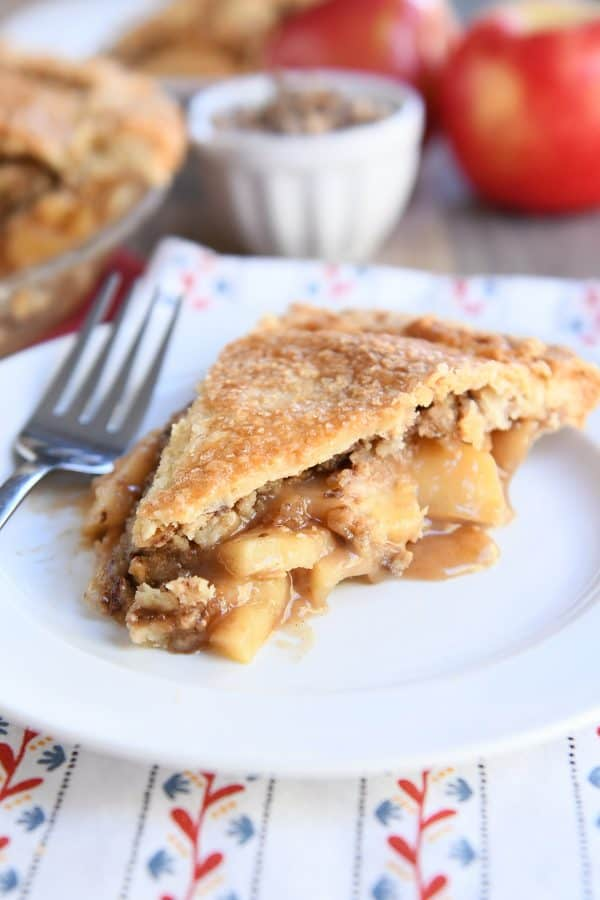 slice of toffee crumble caramel apple pie on white plate