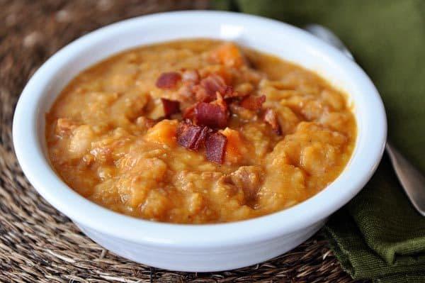 white bowl with ham, sweet potato, bacon, and white bean soup