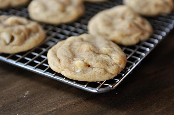 white chocolate macadamia nut cookies on a cooling rack