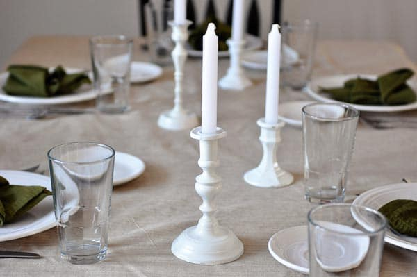 a table set up with a nice candelit dinner setup