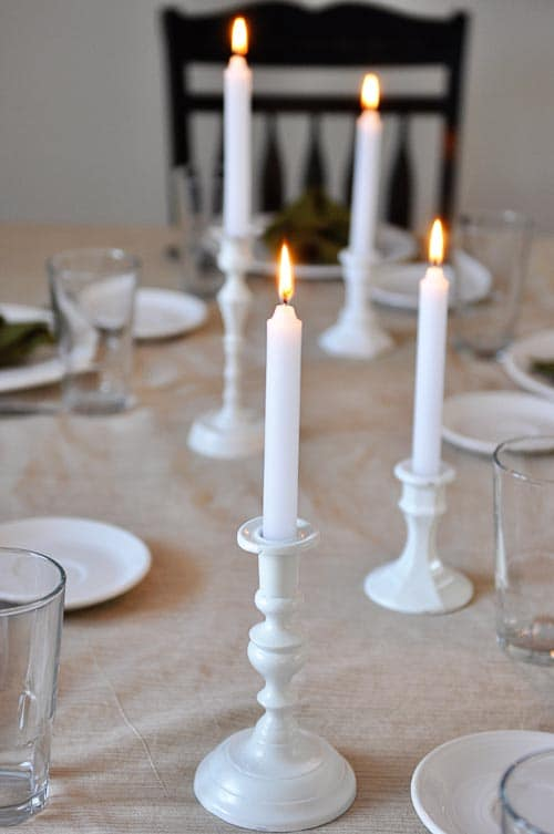 white candles on a nicely set table