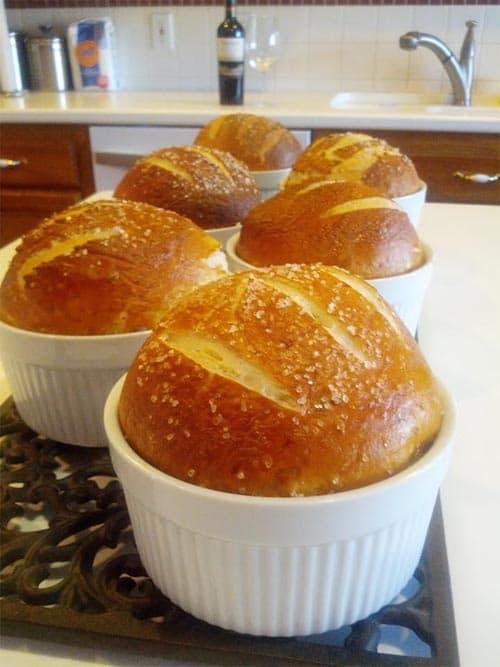 baked pretzel rolls inside white ramekins