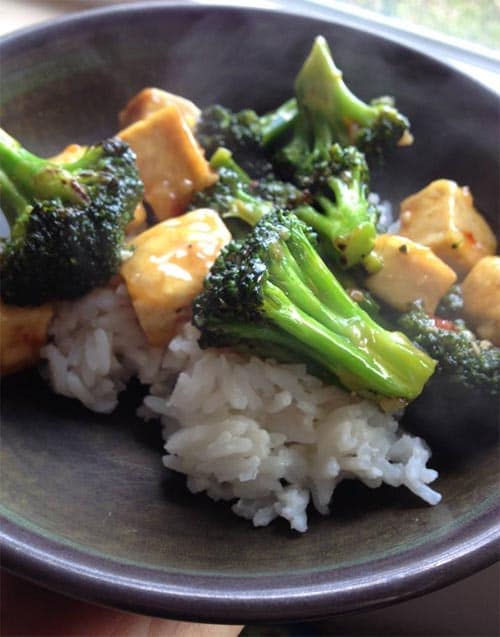 white rice topped with broccoli and chicken