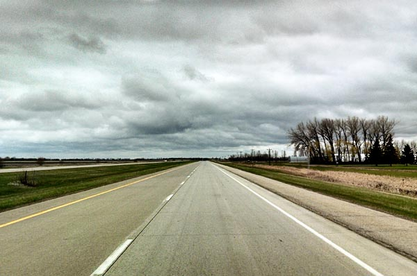 A wide open road with no cars on it.