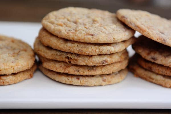 stacks of thin butterfinger cookies on a white platter