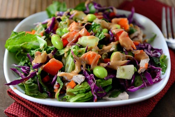 A white plate with a colorful chopped Thai salad.