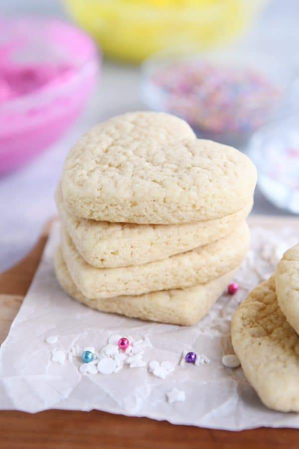four heart shaped sugar cookies stacked on each other
