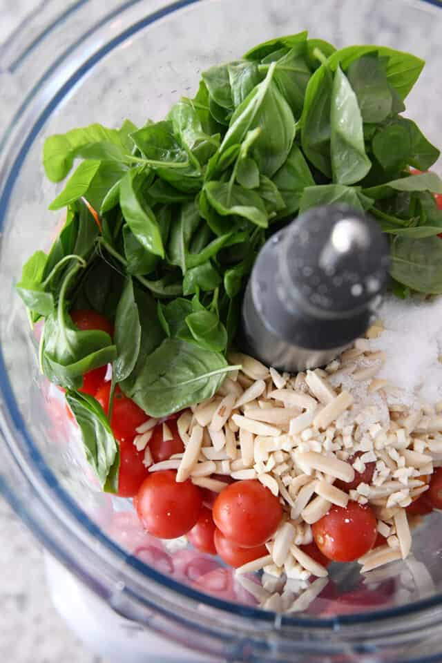 basil, cherry tomatoes, almonds and salt in food processor