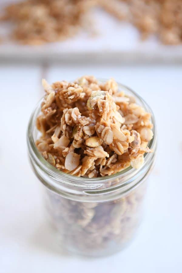 glass jar filled with brown butter pecan granola