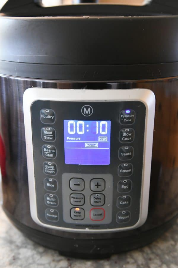 Mealthy pressure cooker set to 10 minutes cook time.