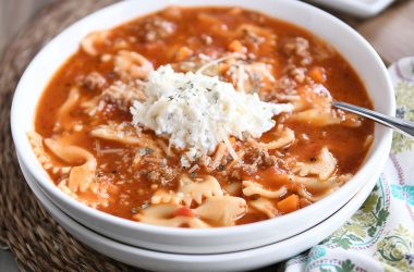 White bowl filled with pressure cooker lasagna soup and dollop of cheesy ricotta mixture.