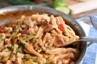 Scooping out spoonful of skillet chicken fajita pasta.