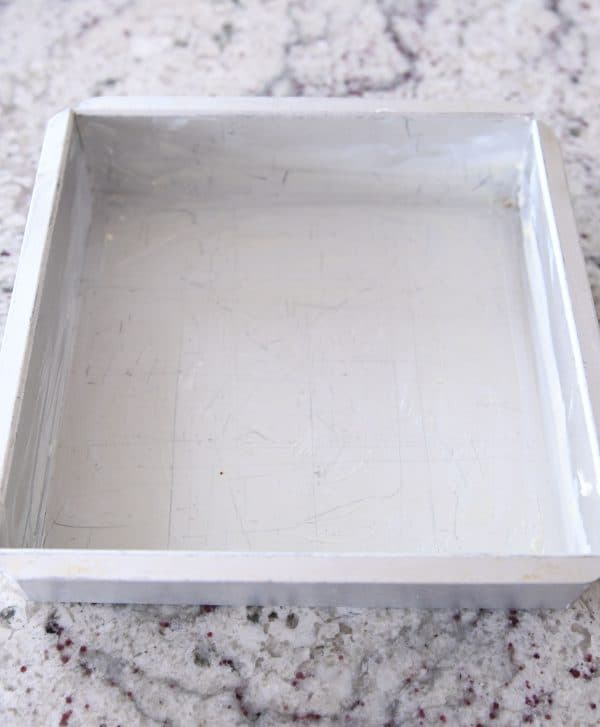 8X8-inch square pan buttered for caramels