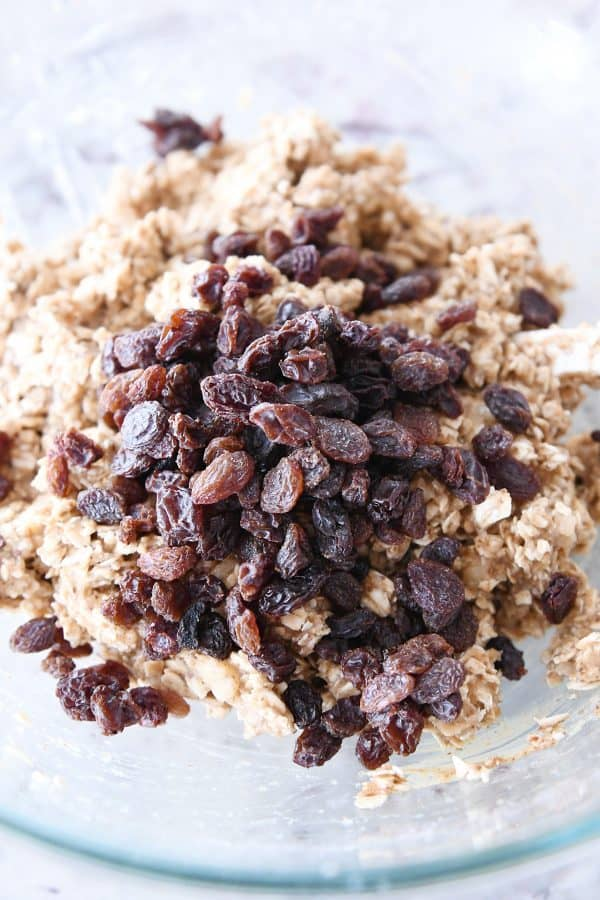 adding raisins to healthy breakfast cookie dough