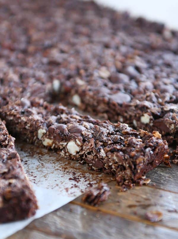 cutting apart dark chocolate brownie granola bars into thin rectangles