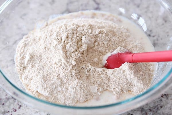 stirring in dry ingredients to english muffin batter
