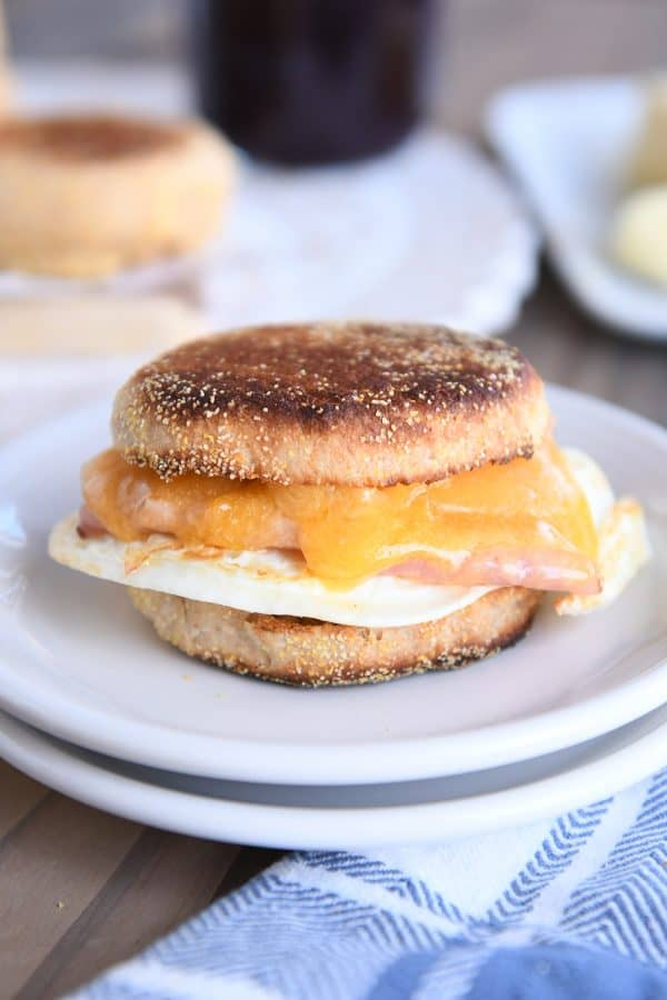 homemade english muffins sandwiched with ham and egg