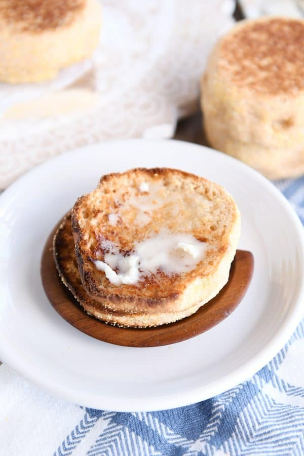 homemade english muffin split open and toasted with butter
