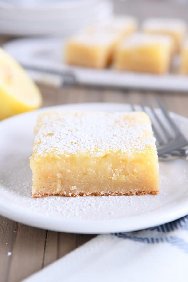 lemon bar white chocolate brownie square on white plate